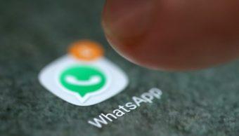 Logo de WhatsApp cómo hacer encuestas en WhatsApp